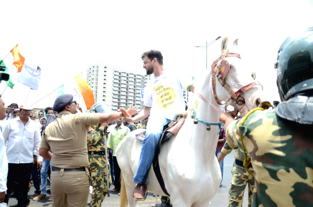 Police stop Congress workers agitating against the hike in petrol and diesel prices, in Mumbai on May 24, 2018.