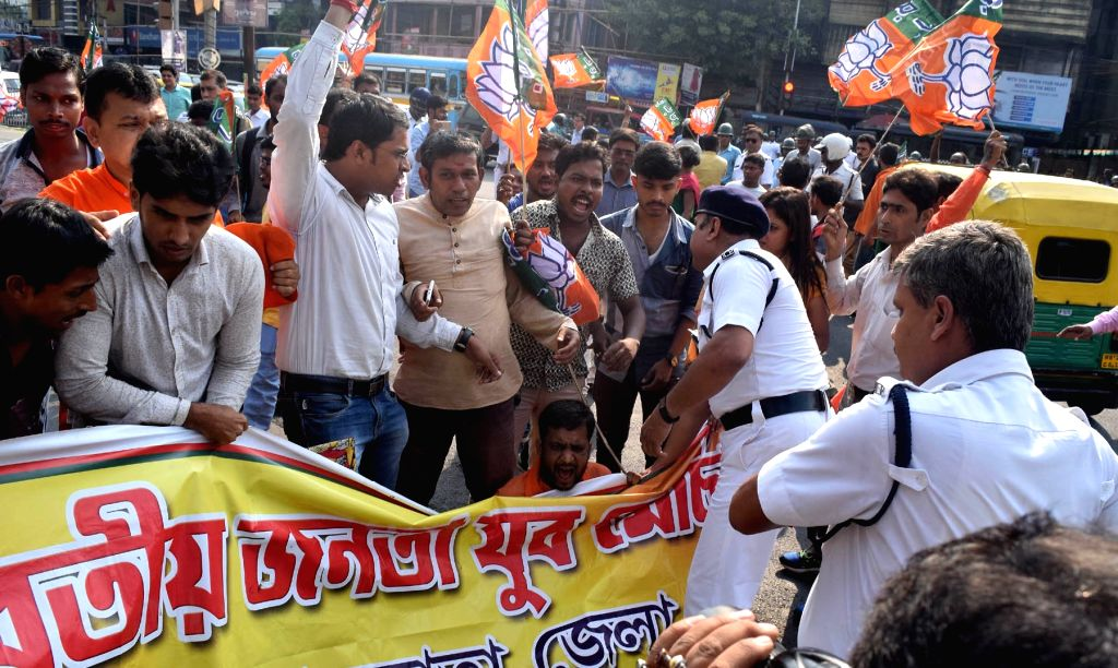 Police stops BJP workers agitating against the West Bengal Government, in Kolkata on Sept 18, 2018.