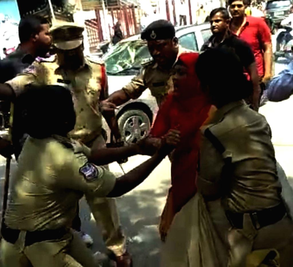 Police take away a protesting relative of a minor girl who was allegedly raped; outside the Azaan International School, in Hyderabad on Sept 15, 2018.