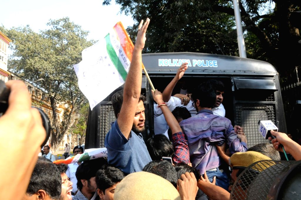 Police take away Congress student wing activists staging a demonstration in front of Raj Bhawan in Kolkata on Feb 20, 2019.