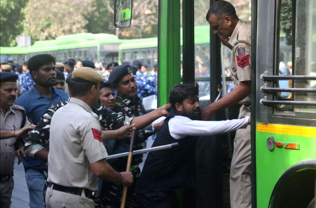 Police take away job aspirants staging a demonstration against alleged SSC exam paper leak, in New Delhi on March 31, 2018.