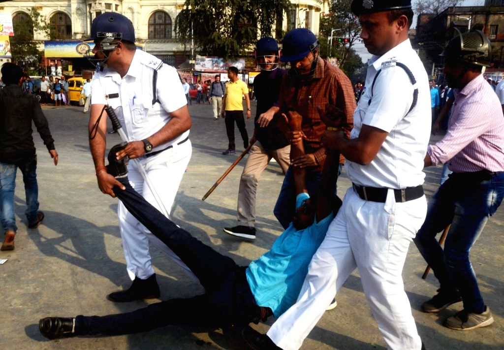 Police take away members of All Bengal Resource Persons Employees Association staging a protest against the state government in Kolkata on Feb 15, 2019.