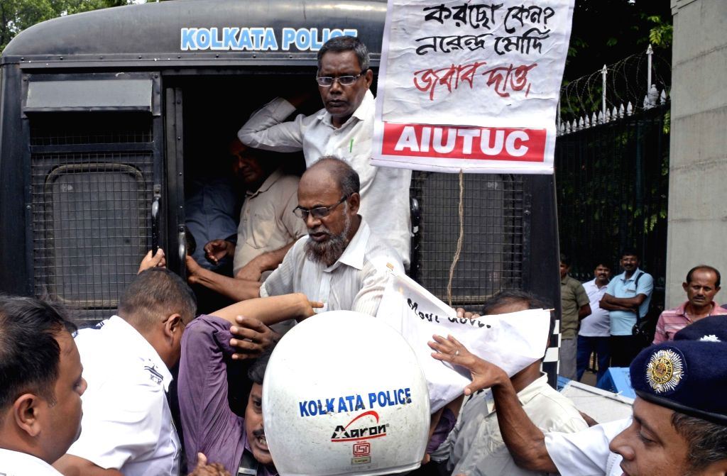 Police take away members of All India United Trade Union Centre (AIUTUC) protesting against the privatization of public sector undertakings (PSUs), outside Raj Bhavan in Kolkata on July 25, ...