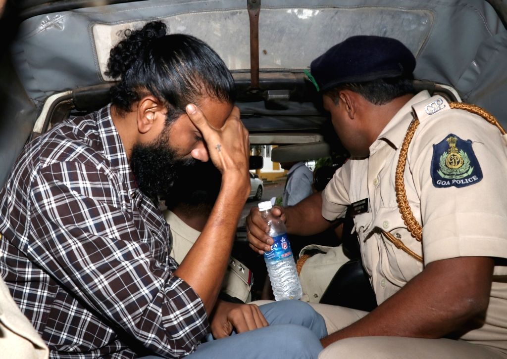 Police take away Samson D'Souza after the Bombay High Court in Goa convicted him - a beach shack worker accused of sexually assaulting 15-year-old British teenager Scarlett Keeling and ...