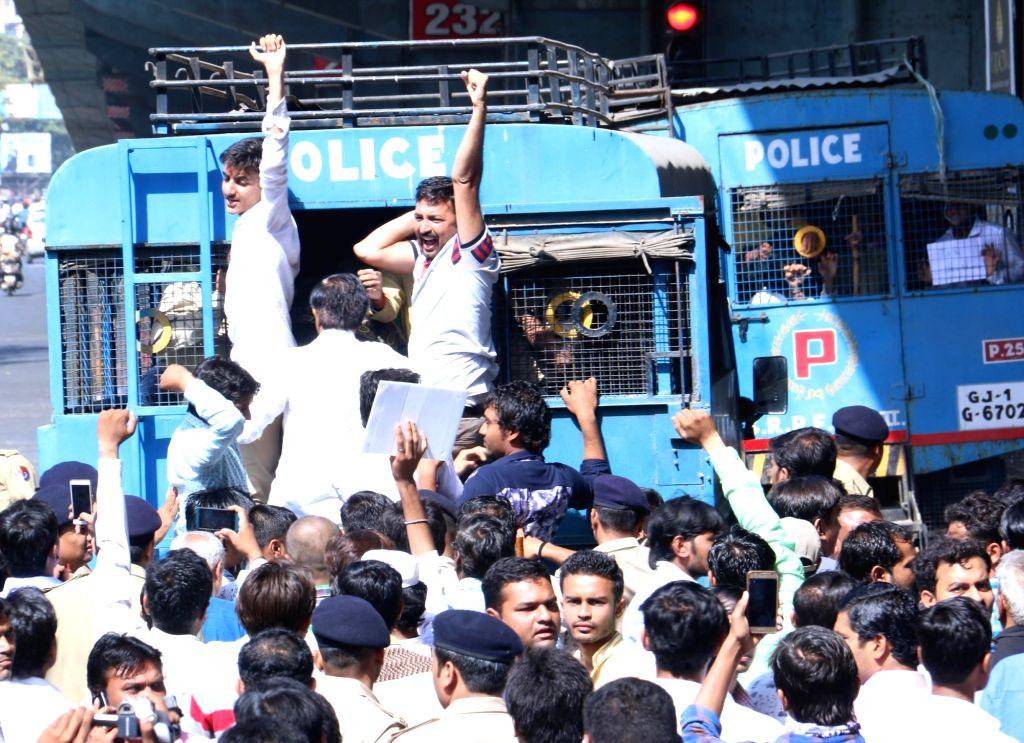 "Police take away the members of Patidar Anamat Andolan Samiti (PAAS) during ""Jail Bharo Andolan"" in Surat of Gujarat on April 17, 2016."