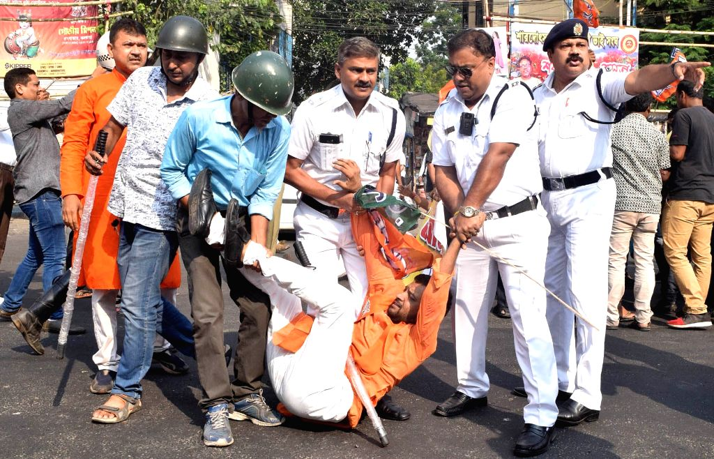 Police takes away a BJP worker agitating against the West Bengal Government, in Kolkata on Sept 18, 2018.