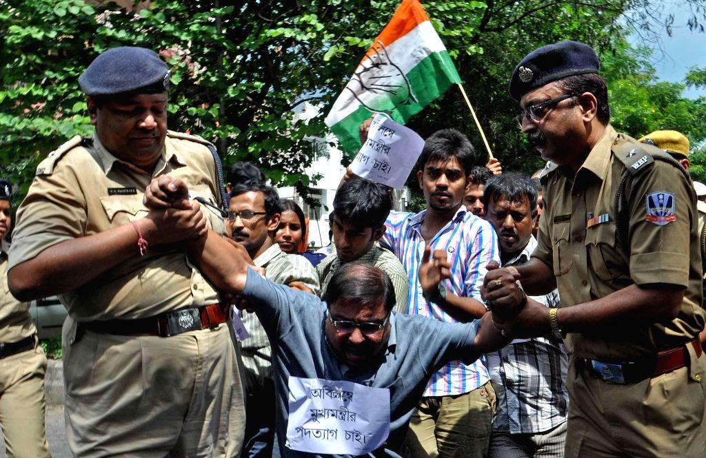 Police takes away a Congress worker demonstrating against Mamata Banerjee led West Bengal Government at Salt Lake in Kolkata on Sept 12, 2014. - Mamata Banerjee