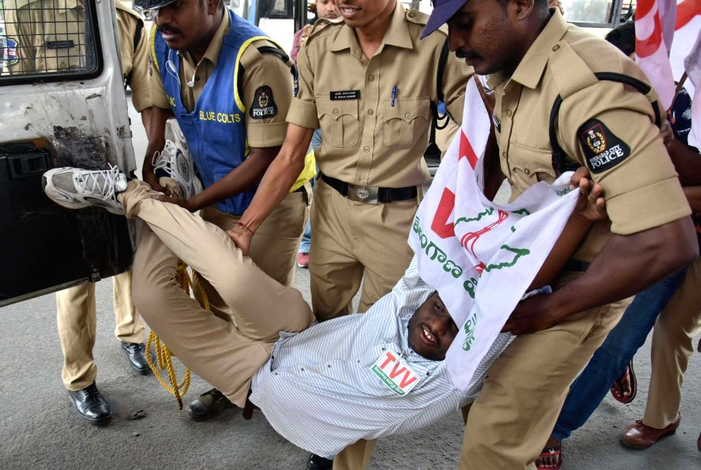 Police takes away a student activist staging a demonstration against the passage of Telangana State Private Universities Bill-2018 in the state assembly, in Hyderabad on March 29, 2018.