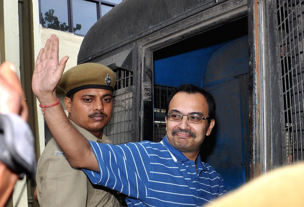 Police takes away suspended Trinamool Congress MP Kunal Ghosh after producing him at a Kolkata court in connection with multi-crore-rupee Saradha chit fund on Sept 12, 2014.