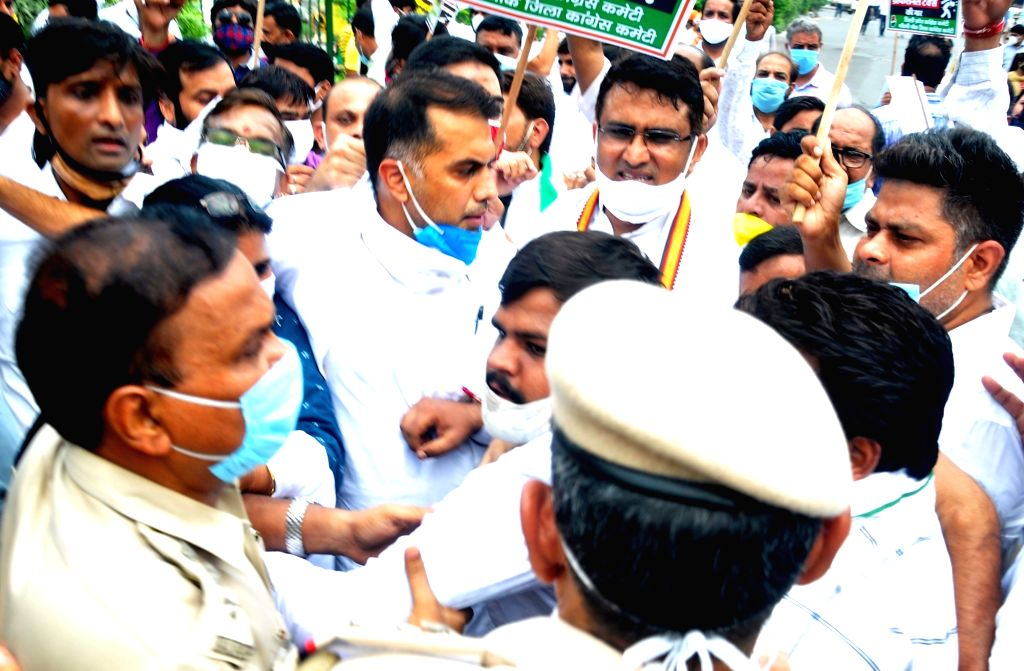 Police thwart Congress' protest against BJP-ruled South Delhi Municipal Corporation's decision to levy professional tax as well as its plan to increase property tax on commercial ...
