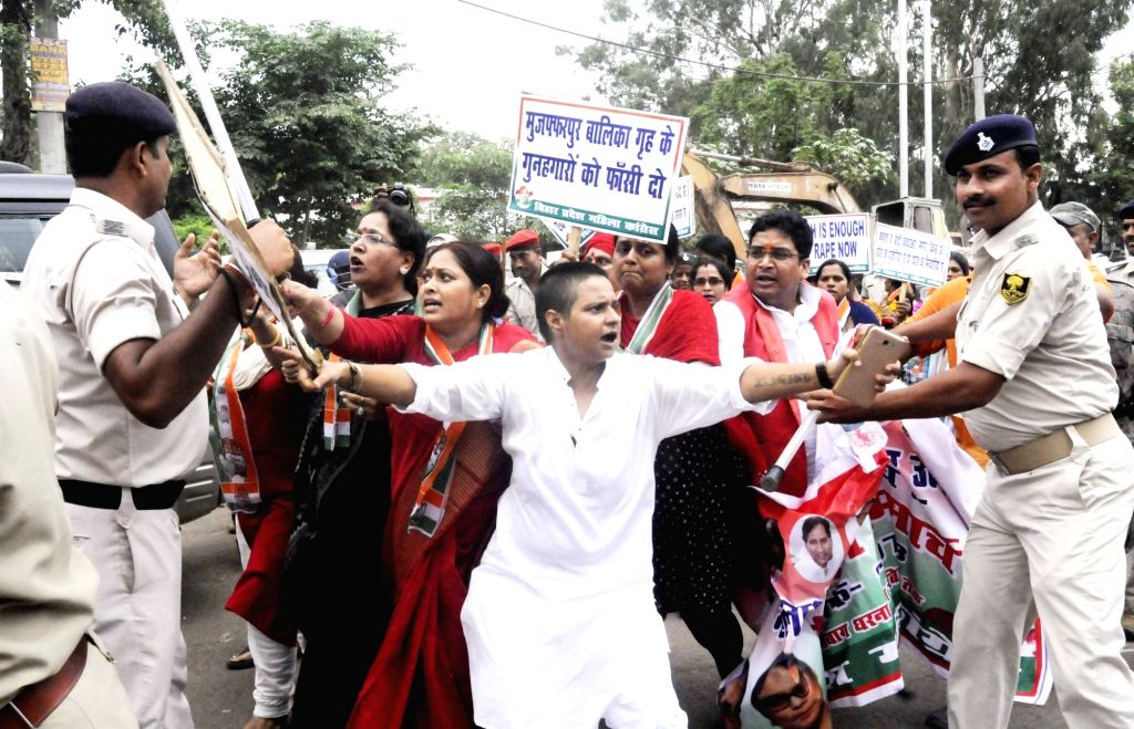 Police thwarts Congress activists' demonstration against increasing incidents of violence against women; in Patna on July 24, 2018.