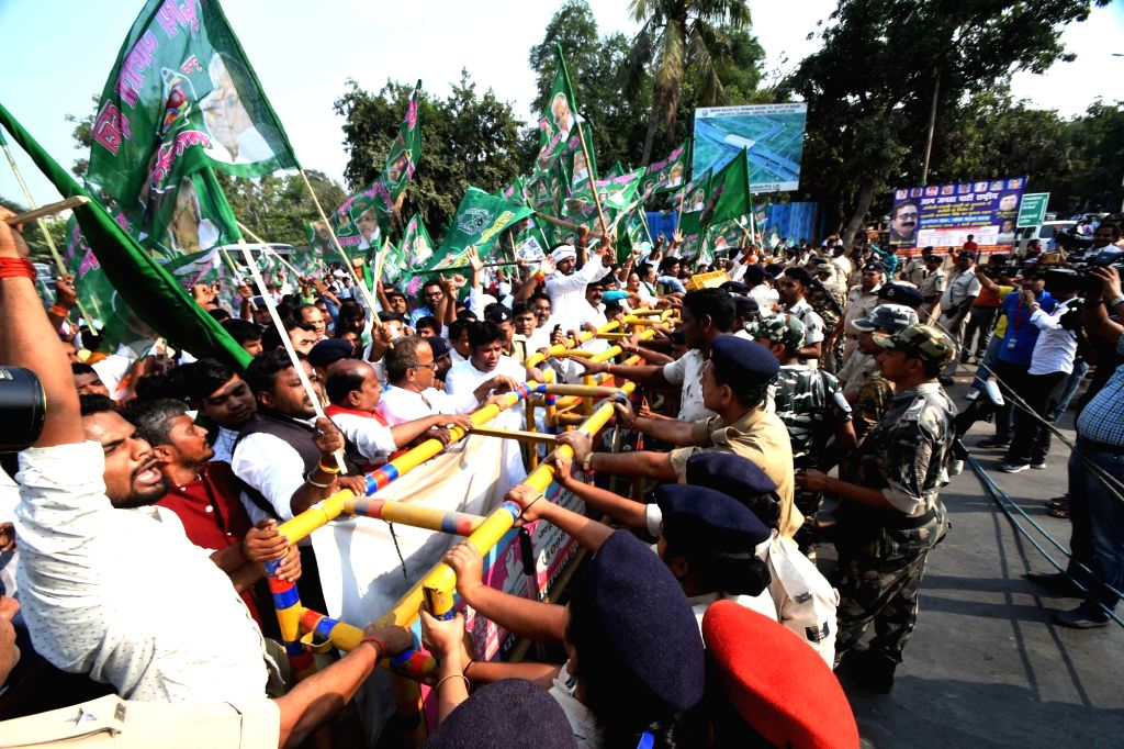 Police tries to stop RJD workers staging a protest march to Raj Bhavan against the Central and the State Governments; in Patna on Nov 4, 2018.