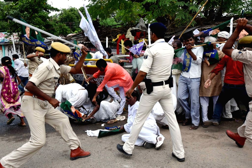 Police uses baton charge to disperse a group of Jantantrik Vikas Party workers protesting against the death of constable Sneha Kumari, in Patna on July 16, 2019.