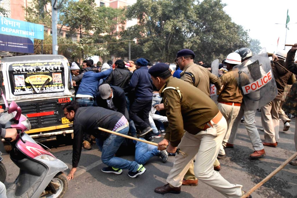 Police uses baton charge to disperse a group of protesters agitating against privatisation, in Patna on Jan 27, 2020.