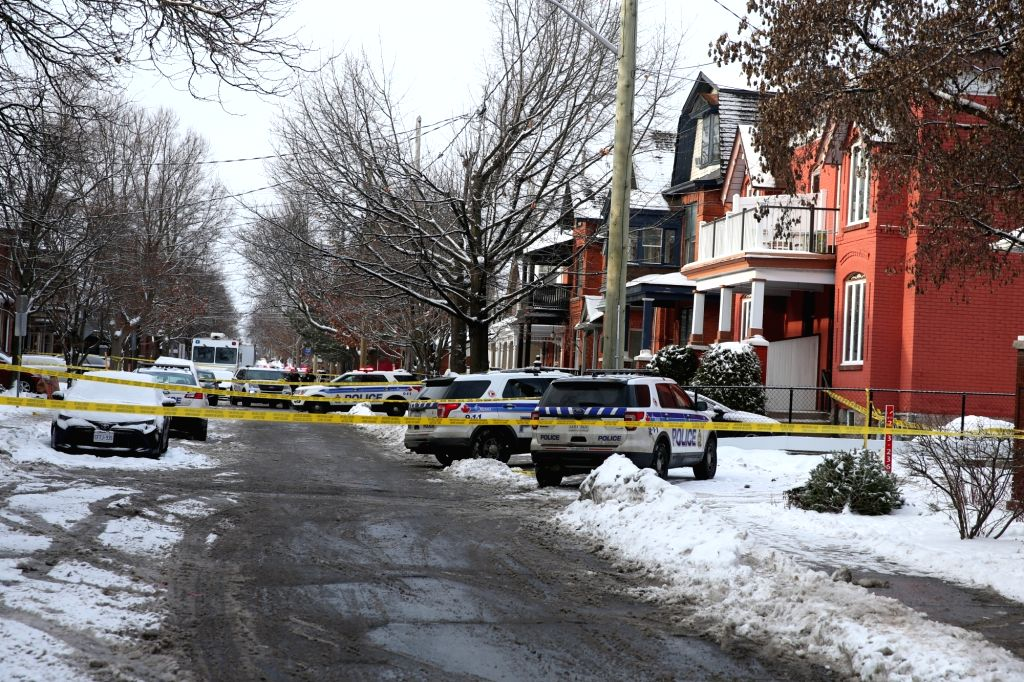Police work at the site of the shooting incident in Ottawa, Canada, Jan. 8, 2020. A shooting incident left one dead and three others wounded in the Canadian capital ...