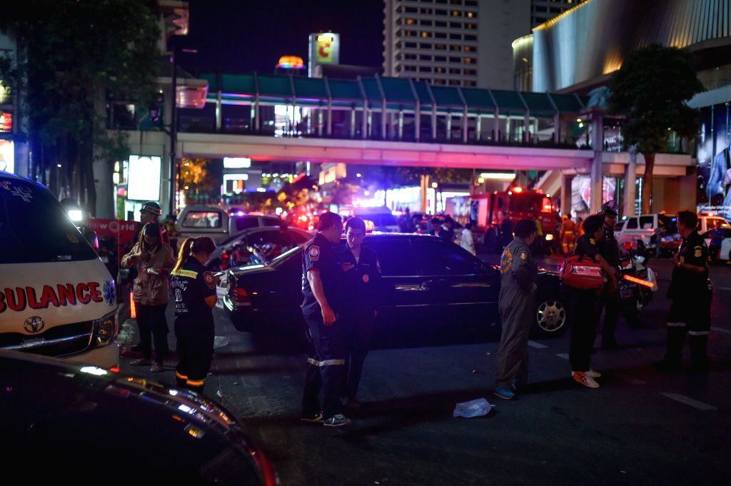 Policemen and rescuers work at the site of an explosion in downtown Bangkok, capital of Thailand, on Aug. 17, 2015. At least 15 people were killed and more than 80 ...