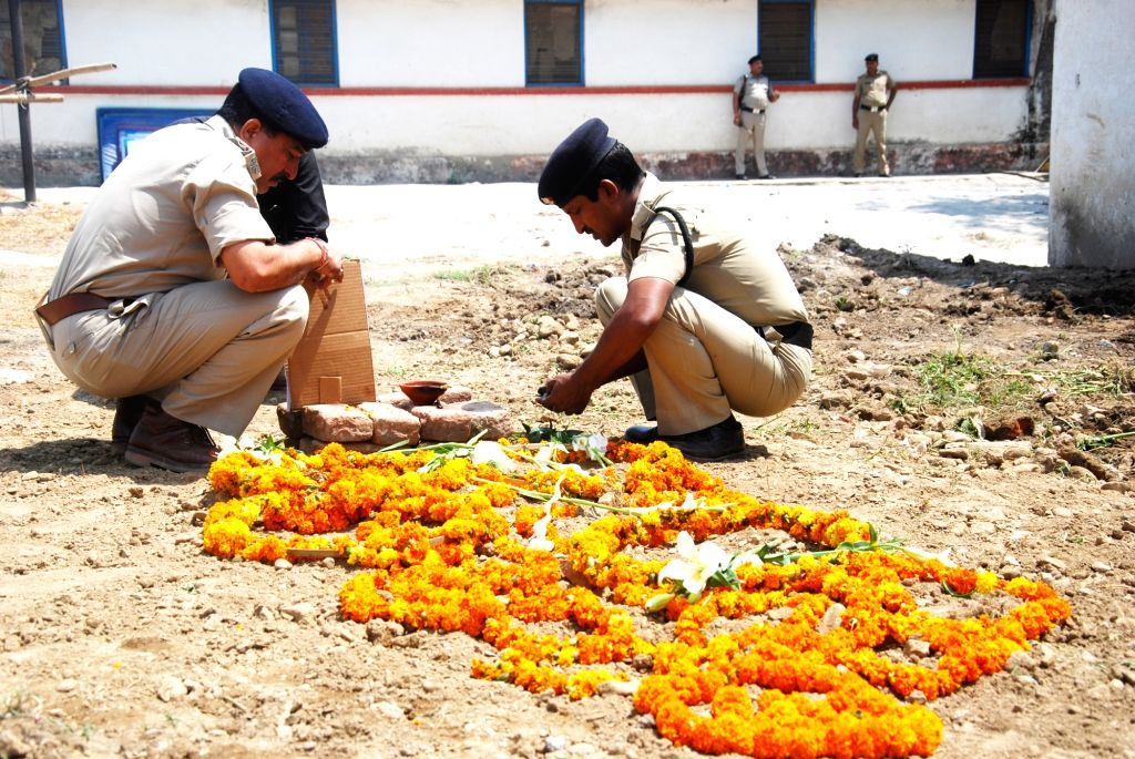 Policemen at the grave of Shaktimaan, a state police horse who lost a leg in an attack by a Bharatiya Janata Party (BJP) legislator last month and died days after it got a prosthetic limb ...