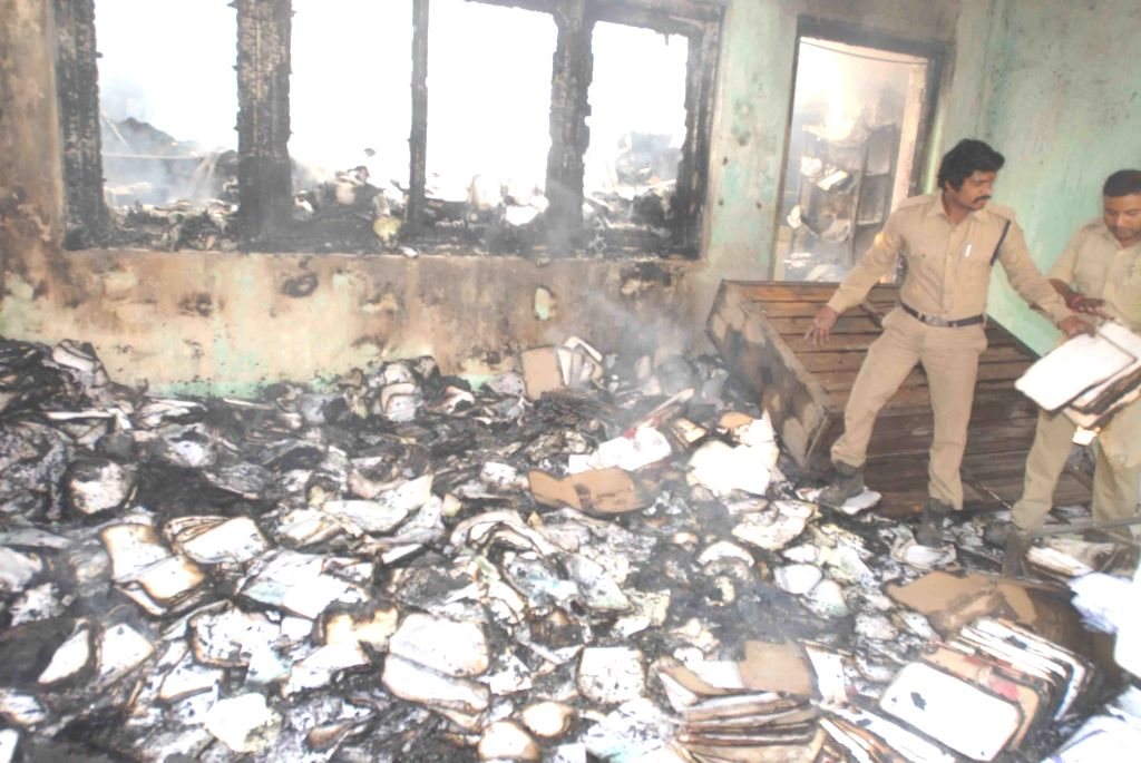 Policemen at the record room of Road Transport Authority (RTA) office that caught fire at Khairatabad in Hyderabad on Jan 24, 2018.