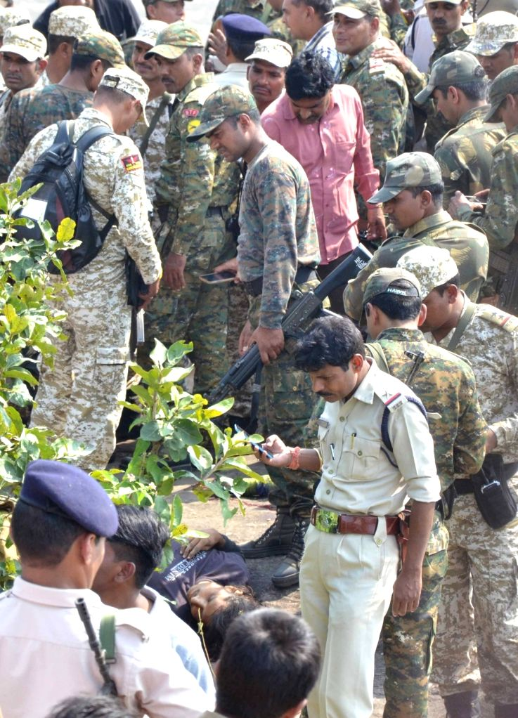 Policemen at the site where eight terrorists of the banned Students Islamic Movement of India (SIMI) who escaped from Bhopal Central Jail were killed in a gunfight on the outskirts of the ...