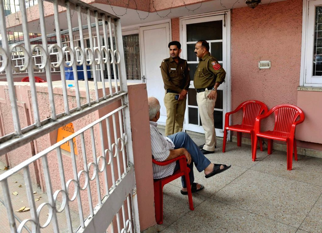 Policemen carry out investigations at the residence of Manohar Lal Madan (86), a retired Punjab National Bank employee, and his wife Vimla Madan (80) where they were found dead, at East of ...