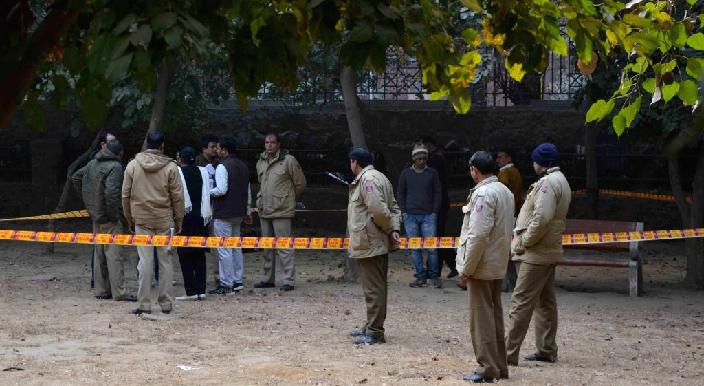 Policemen carry out investigations at the site where a Delhi Police sub-inspector shot dead a woman with his service revolver and then turned the gun on himself in New Delhi on Jan 17, ...
