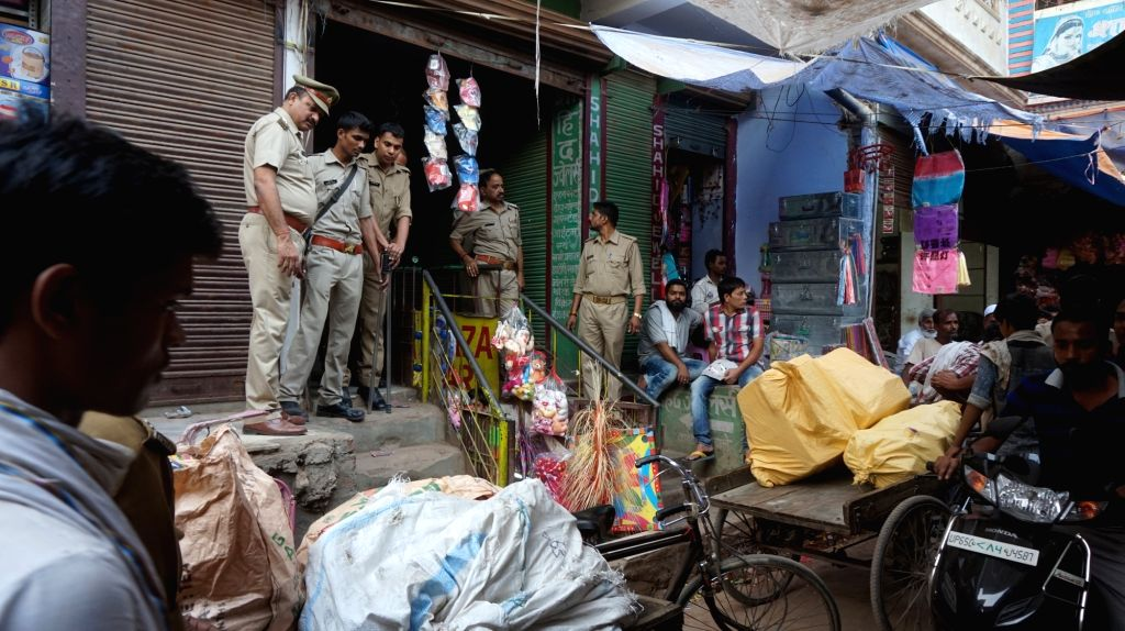 Policemen carry out raids to seize illegal crackers a Varanasi market on Oct 27, 2016.