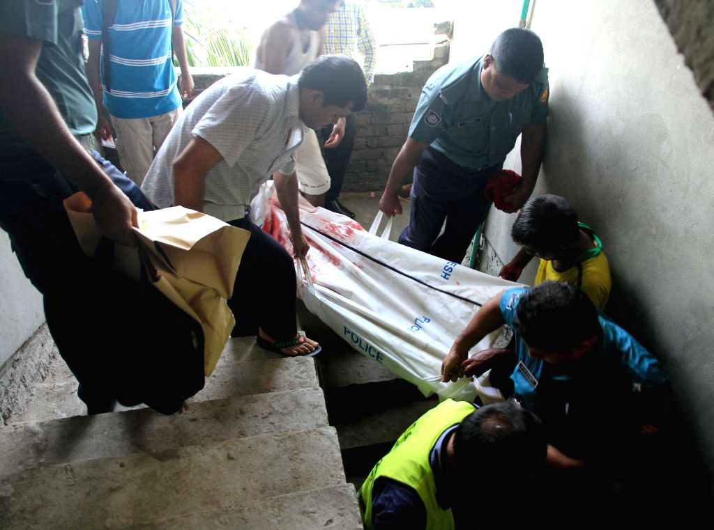 Policemen carry the body of a blogger after he was stabbed to death at his residence in Dhaka, Bangladesh, Aug. 7, 2015. Unidentified attackers on Friday hacked a ...