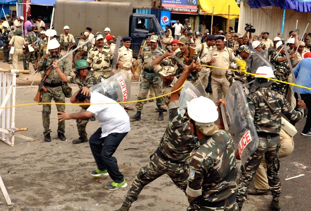 Policemen charge batons on NSUI activists staging a protest against Jharkhand Land Acquisition Bill, 2017 in Ranchi, on July 18, 2018.