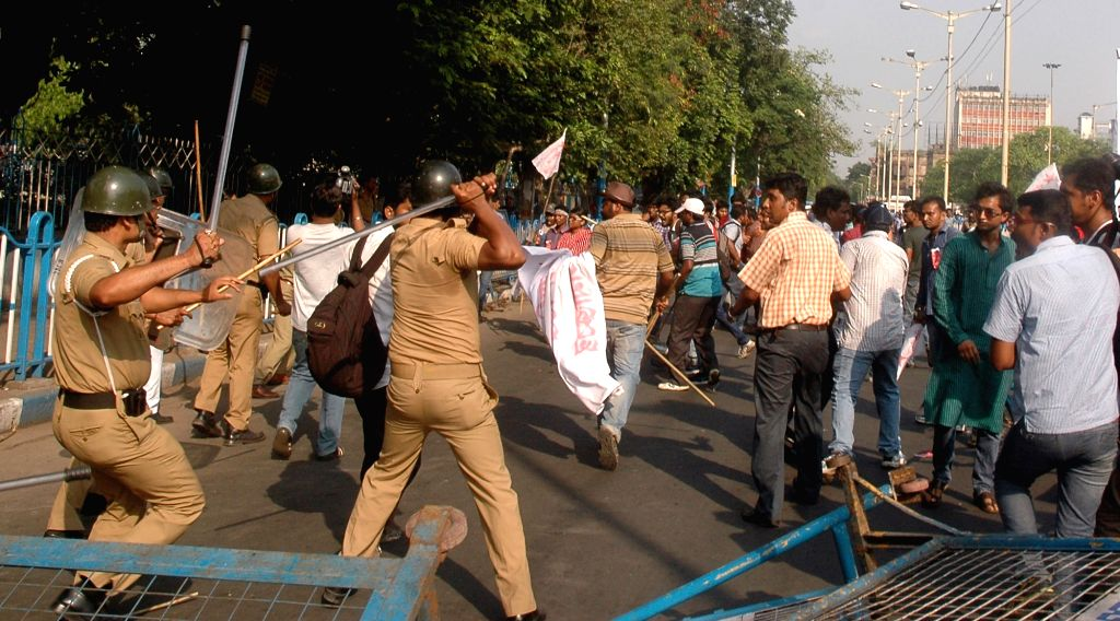 Policemen charge lathis on SFI activists demonstrating against West Bengal Government in Kolkata, on April 2, 2015.