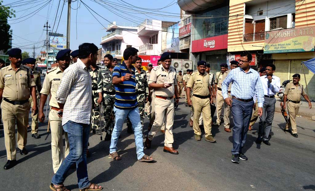 Policemen conduct flag march in Gwalior on April 4, 2018.