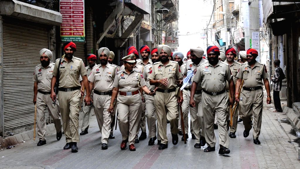 Policemen conduct flag march on the anniversary of Operation Bluestar in Amritsar on June 6, 2017.
