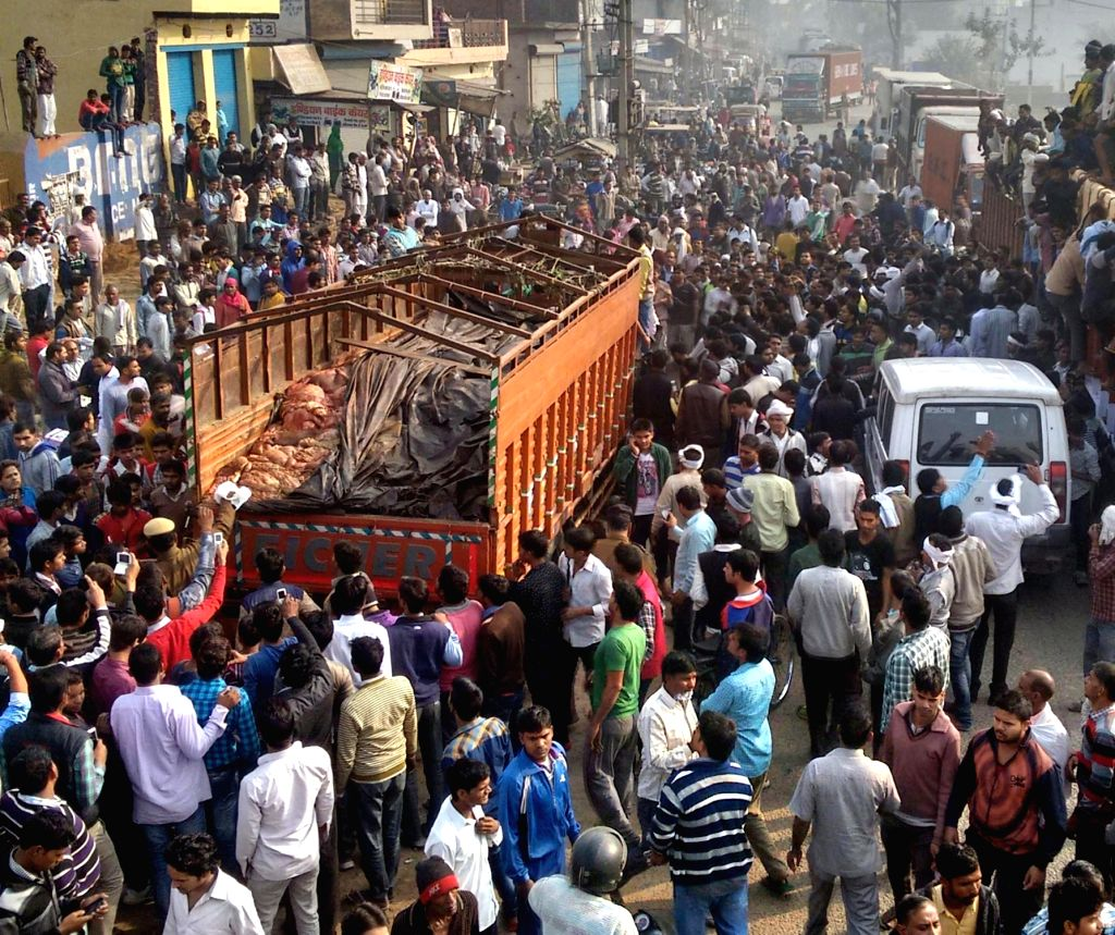 Policemen deployed in Palwal to contain a mob that turned violent after intercepting a truck allegedly carrying beef  on Dec 3, 2015.