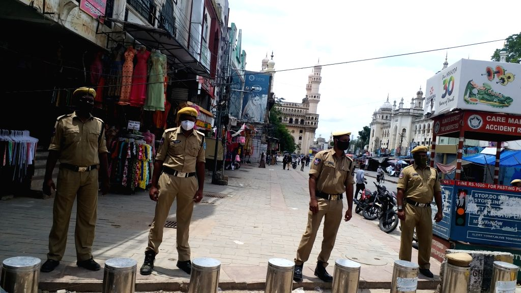 Policemen deployed near the Mecca mosque that remains closed for Friday prayers amid rising coronavirus cases, in Hyderabad on July 3, 2020.