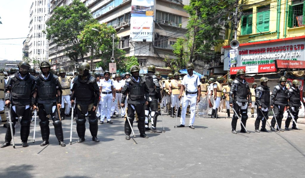Policemen deployed to contain BJP workers protesting against the law and order situation in West Bengal and fake cases lodged against their party workers among other issues in Lalbazar of ...