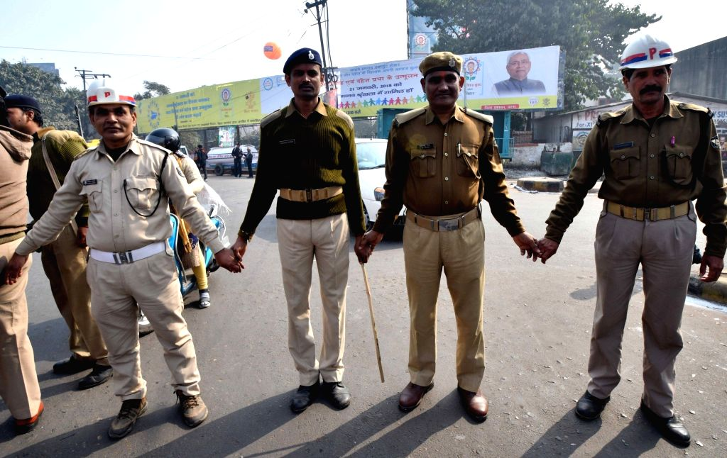 Policemen form a human chain to protest against dowry and child marriage in Patna on Jan 21, 2018.