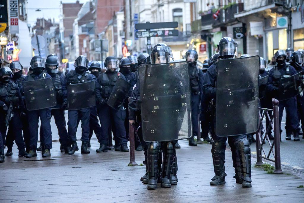Policemen keep guard during a demonstration against pension reform in Lille, north France, Jan. 9, 2020. France's transport strike against President Emmanuel Macron's ...