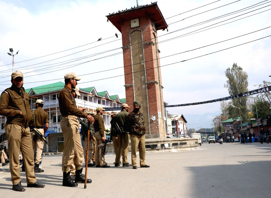 Policemen man a Srinagar road during a shutdown called by the separatists on Oct 27, 2015.