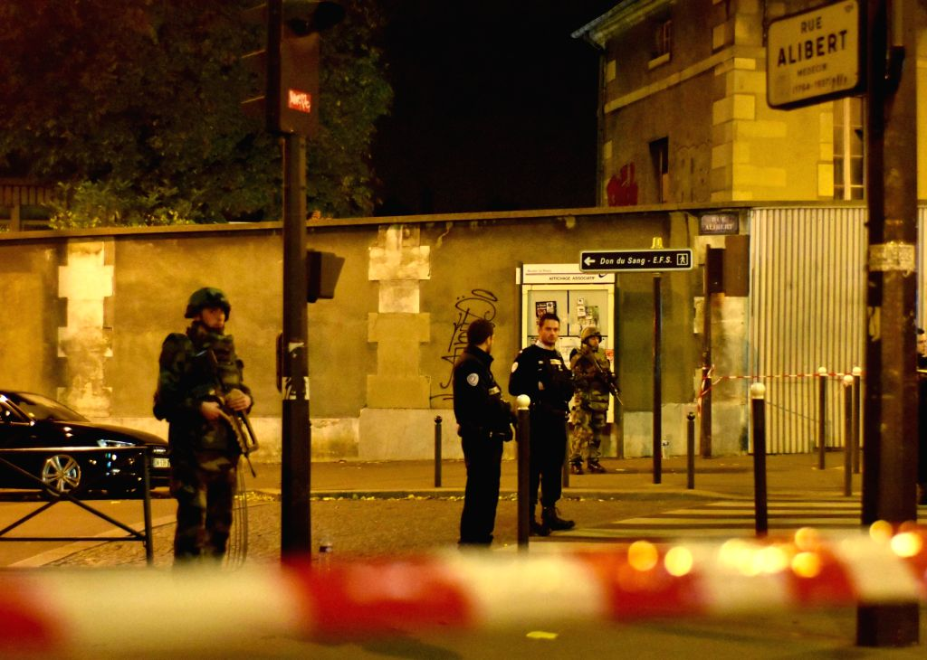 :Policemen patrol near an attacked restaurant in Paris, France, Nov. 13, 2015. Over 100 people have been reportedly killed and many more wounded in a series of what ...