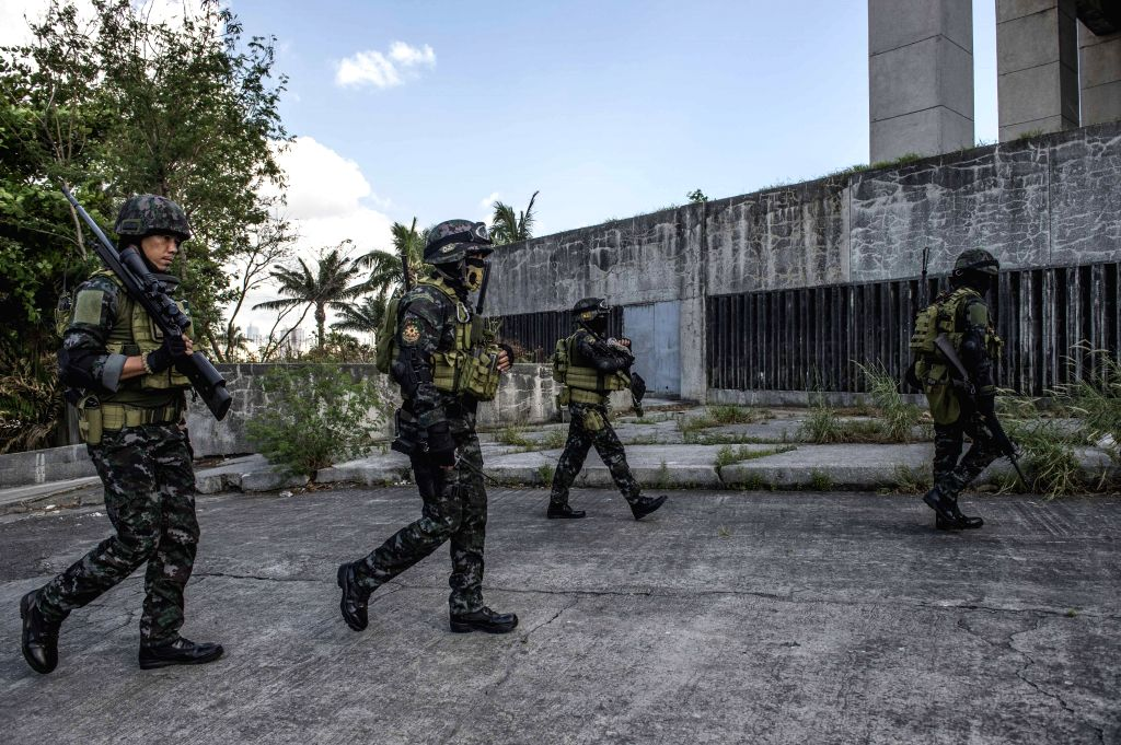 Policemen patrol near the venue of the Asia-Pacific Economic Cooperation (APEC) Leaders' Meeting in Manila, Philippines, on Nov. 14, 2015. Security measures in ...