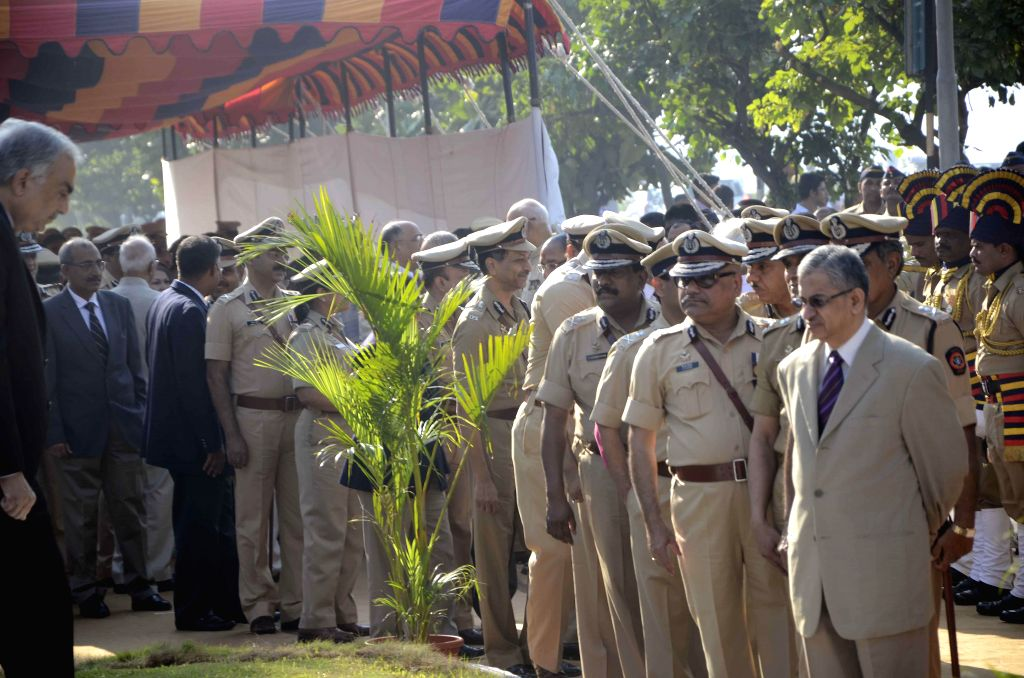 Policemen pay homage to those killed in the 26/11 attacks during a programme at Police Gymkhana in Mumbai on Nov.26, 2014.Ten heavily armed Pakistani terrorists had landed undetected in Mumbai's ...
