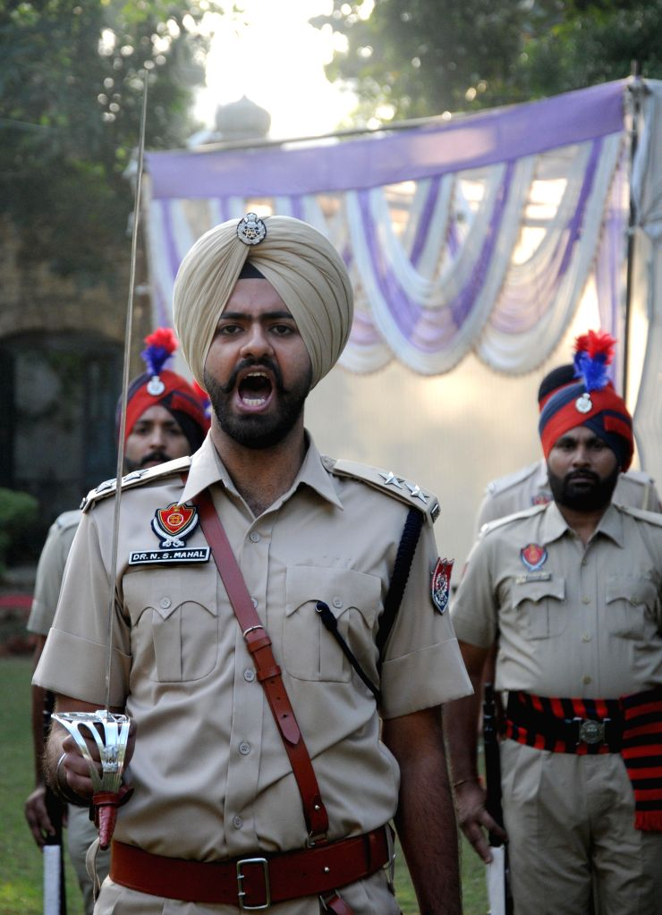 Policemen pay tribute to martyrs during  Police Commemoration Day Parade in Amritsar, on Oct 21, 2015. (Photo: IANS)