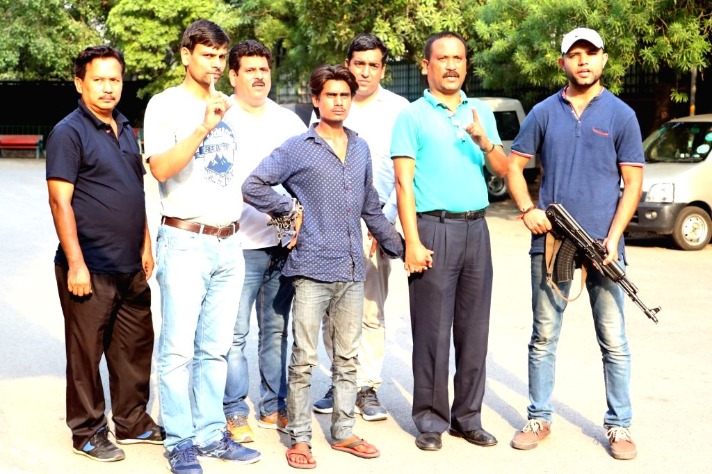 Policemen present before press a suspected arms dealer who was arrested, in New Delhi on June 4, 2016.