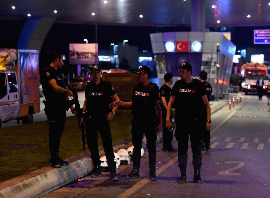 Policemen stand guard outside Ataturk International Airport in Istanbul, Turkey, June 29, 2016. Turkish Prime Minister Binali Yildirim on Wednesday blamed the Islamic State for the bombing ... - Binali Yildirim