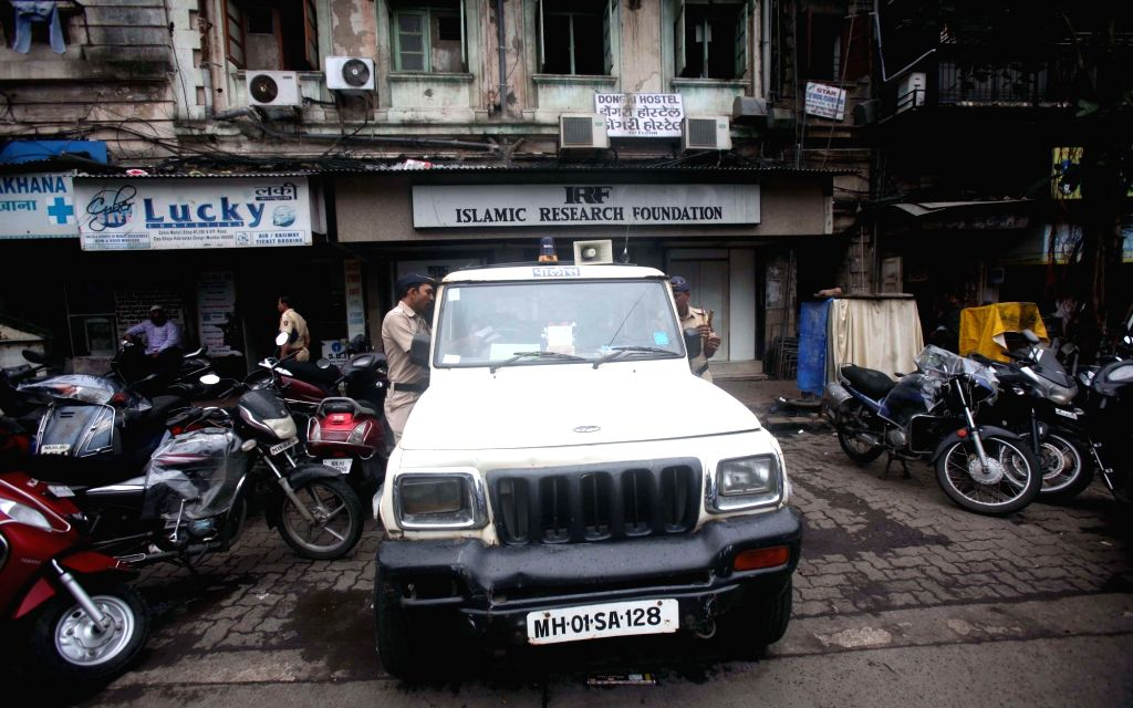 Policemen stand guard outside Mumbai-based controversial Islamic preacher Zakir Naik's Islamic Research Foundation in Mumbai, on July 11, 2016. Naik is under the scanner following revelations ...