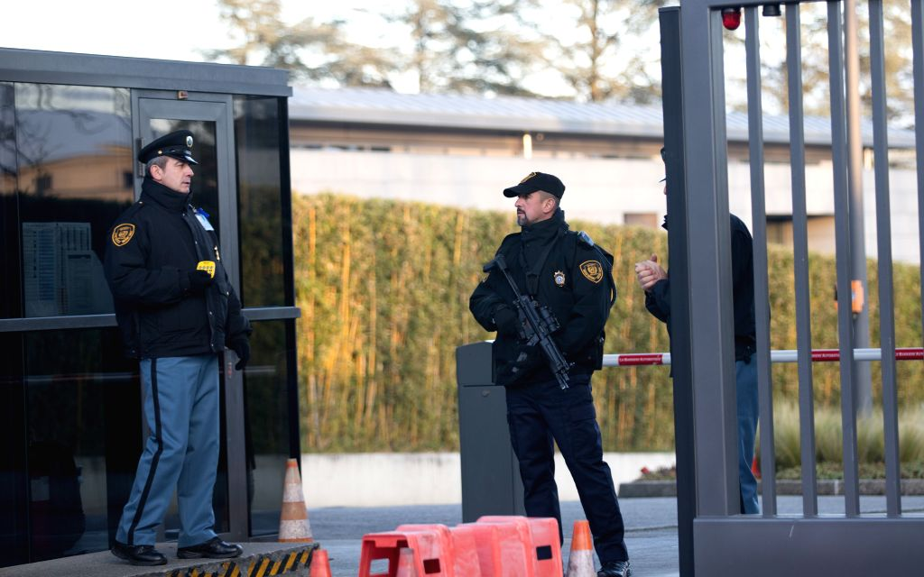 Policemen stand on duty at the United Nations Office at Geneva, Switzerland, Dec. 10, 2015. Police force in Geneva said that they raised local security alert level on Thursday and started ...