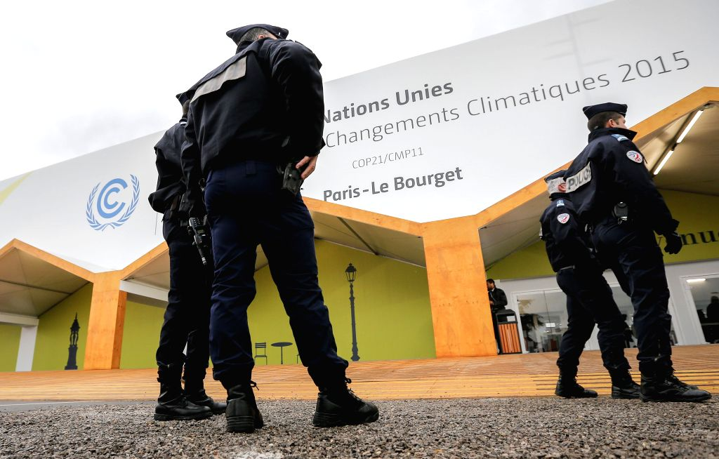 Policemen stand on guard at Le Bourget where the 2015 United Nations Climate Change Conference (COP 21) will take place in Paris, France, Nov. 29, 2015. Already at ...