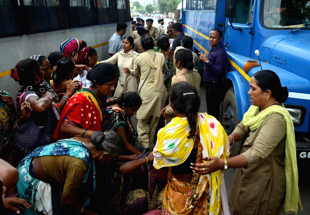 Policemen take away dalits staging a demonstration against  them in Ahmedabad on Sept 19, 2016.