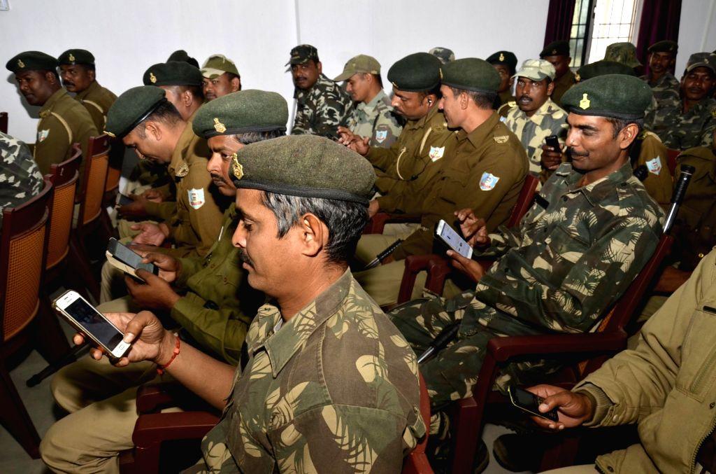 Policemen undergo  a training session on cashless transactions in Ranchi on Nov 29, 2016.