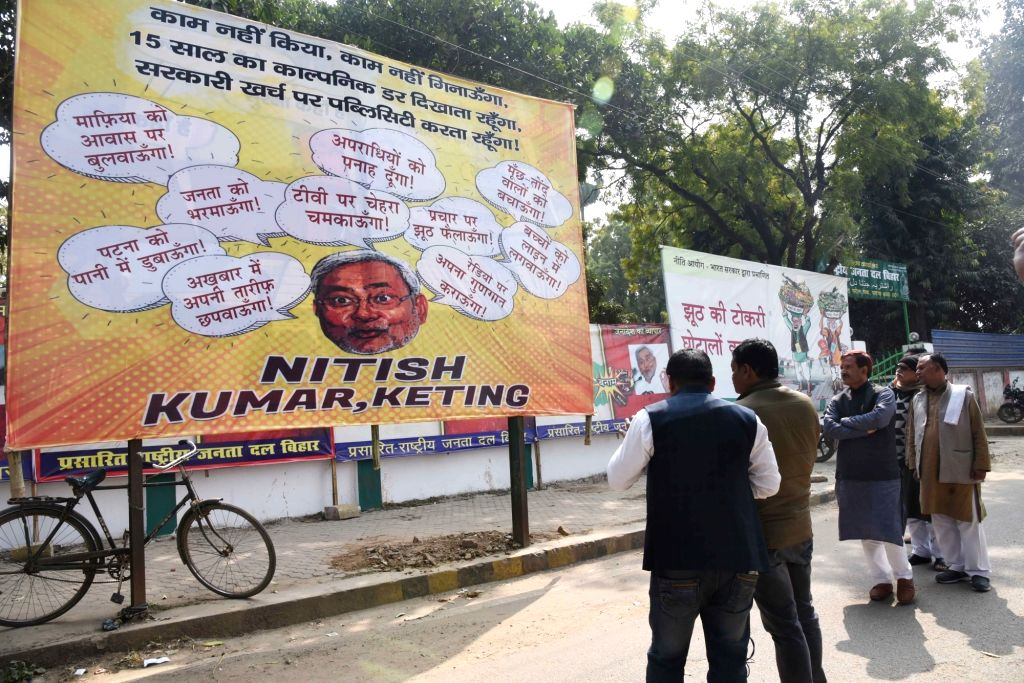 Political posters put up by RJD mocking Bihar Chief Minister Nitish Kumar ahead of state assembly elections, in Patna on Feb 8, 2020. - Nitish Kumar