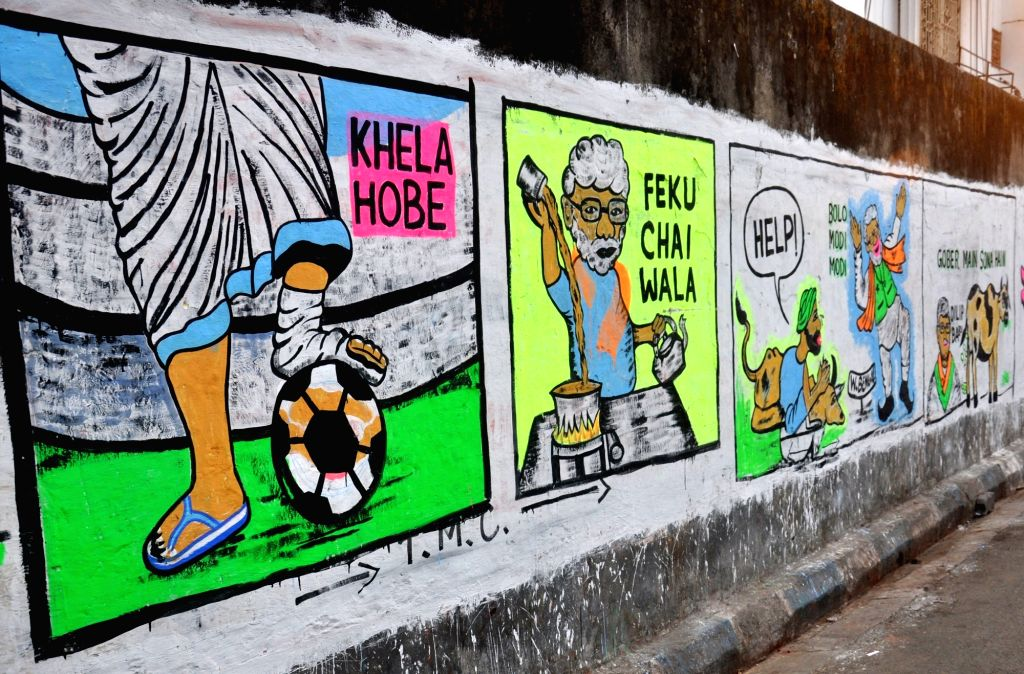 Political wall graffiti during State Assembly election in Kolkata on March 30, 2021.